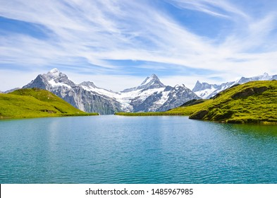 Beautiful Bachalpsee in the Swiss Alps photographed with famous mountain peaks Eiger, Jungfrau, and Monch. Lake and Alpine landscape. Switzerland in late summer. Snow-capped mountains, mountain range.