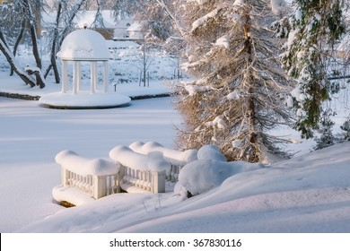 Beautiful back yard in Palmse manor. Top view on snow-covered pond and gazebo. Large snow drifts without a trace. The attraction of the national Park Lahemaa. Estonia. Winter.