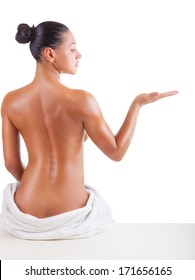 Beautiful back of a young woman on white background