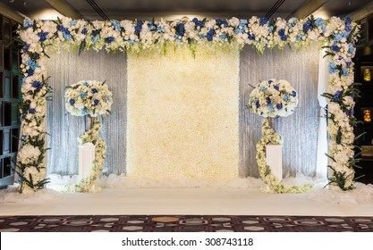 Beautiful backdrop flowers over white fabric ready for wedding ceremony.