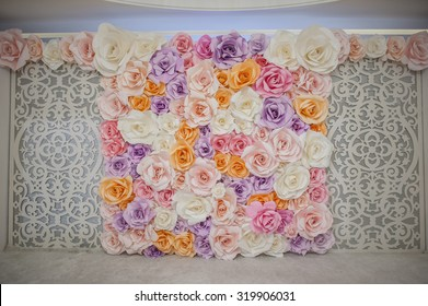 Beautiful backdrop flowers over white fabric decoration ready for wedding ceremony.
