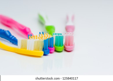 Beautiful background of colored toothbrushes