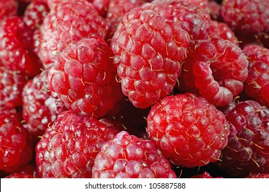 Beautiful background consisting of a mouth-watering raspberries
