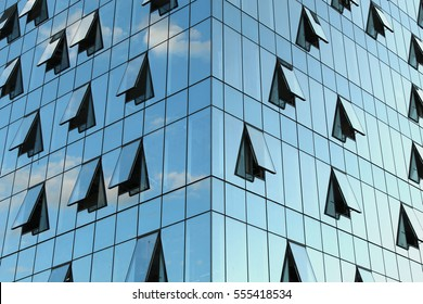 A beautiful background of an glass office building, reflecting clouds in the opened windows