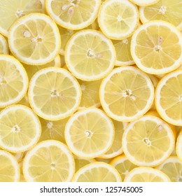 Beautiful background made of juicy lemon slices
