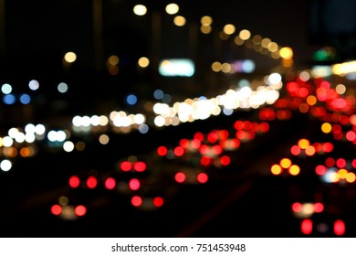 Beautiful background on dark, out of Focus Lights during the Night. Car traffic on Jeddah Saudi Arabia