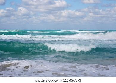 Beautiful background picture of turquoise waves crashing on the shore of Varadero, Cuba