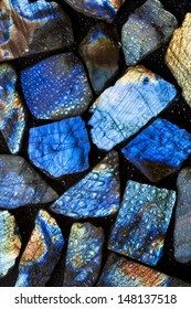 Beautiful background picture of wet natural labradorite gem stones.