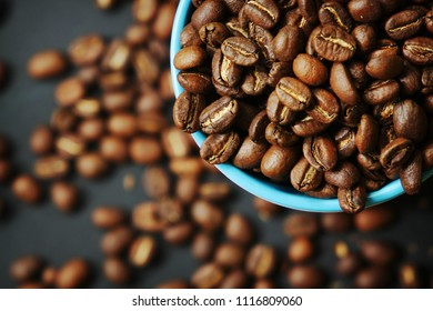 Beautiful background with scattered coffee beans