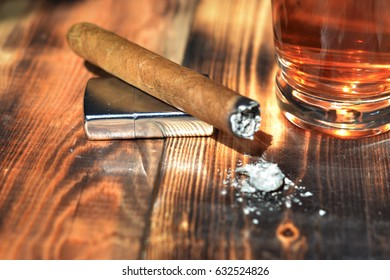 Beautiful background of a table with wood on it cigars, coffee, cognac.