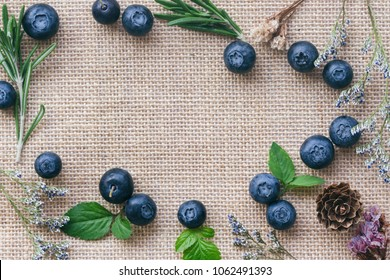 Beautiful background or wallpaper of fresh wild blueberries lay on sack in top view flat lay with copy space for fill text. Blueberry is antioxidant food and have vitamin C. Healthy fruits concept.