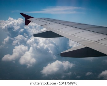 Beautiful background,Aircraft wing flying over clouds in blue sky.