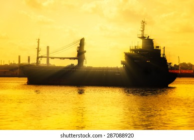Beautiful backlit image of a commercial cargo ship at sunset