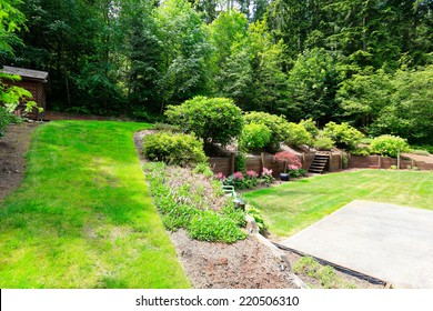 Beautiful backyard landscape and garden view. Garden with wooden trim and stairs