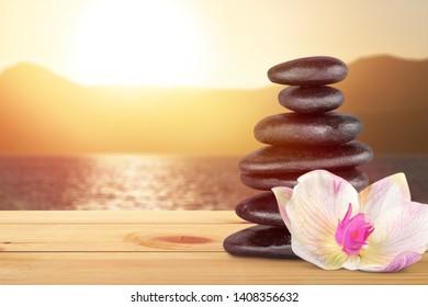 Beautiful Balance concept, zen black stone on beach background