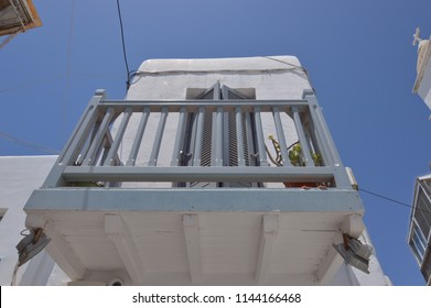 Beautiful Balconies In The Picturesque Streets Very Narrow Full Of Shops In Chora Island Of Mikonos .Arte History Architecture July 3, 2018. Chora, Mykonos Island, Greece.