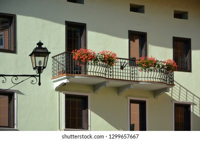 A beautiful balcony with red flowers in the Italian Alpine village Cavalese