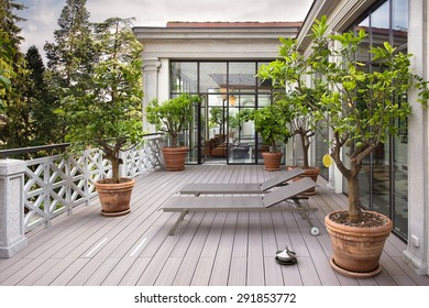 Beautiful balcony with sunbeds and plants with beautiful view of the mountains on the background and blue sky