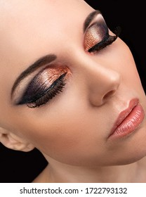Beautiful bald model wearing glamorous makeup