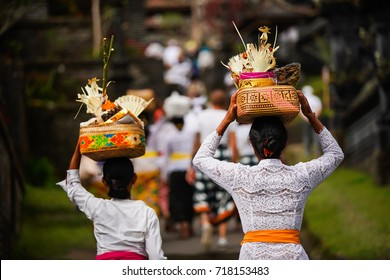 beautiful Balinese women in traditional costumes Batik and Kebaya ,Indonesia woman in traditional clothes carrying ceremonial offerings on her head