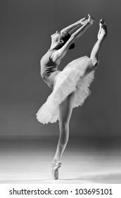 beautiful ballerina in white tutu doing acrobatics