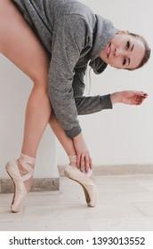 Beautiful ballet dancer in her studio full of light