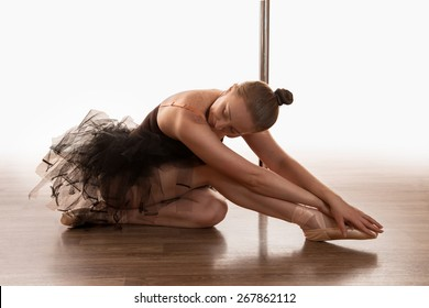 beautiful ballet dancer in the pole dance hall