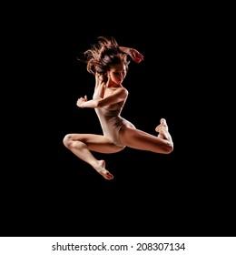 beautiful ballet dancer posing on black studio background
