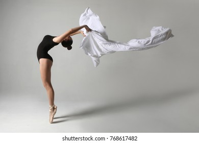 Beautiful Ballet Dancer in Studio on White Background
