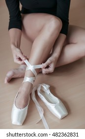 Beautiful ballet-dancer, modern style dancer posing on studio