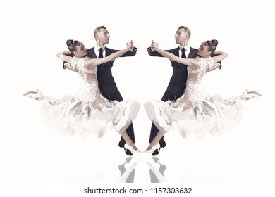 beautiful ballroom dance couple in a dance pose isolated on white background. sensual proffessional dancers dancing walz, tango, slowfox and quickstep. ballroom dancers dance quickstep.