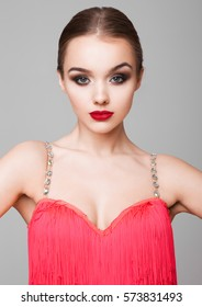 Beautiful ballroom dancer girl portrait red dress on grey background