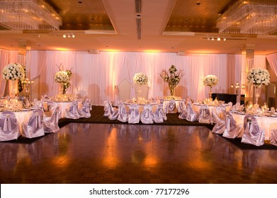 Beautiful ballroom decorated with flowers for a reception