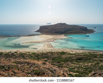 Beautiful Balos lagoon on Crete island, Greece. Tourists relax and bath in crystal clear water of Balos beach. June, 2018