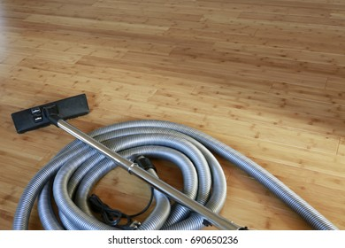 Beautiful bamboo hardwood floor with a central vacuum cleaner