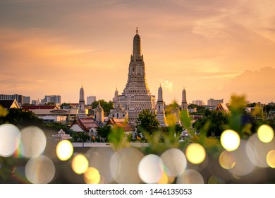 Beautiful Bangkok iconic landmark Wat Arun at dusk with beautiful foreground bokeh lights bulb.