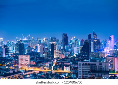 Beautiful Bangkok skyline at night blue hour in the city center business and travel place.