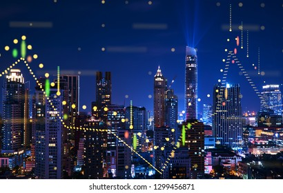 Beautiful Bangkok skyline at night with financial chart state blend in effect .