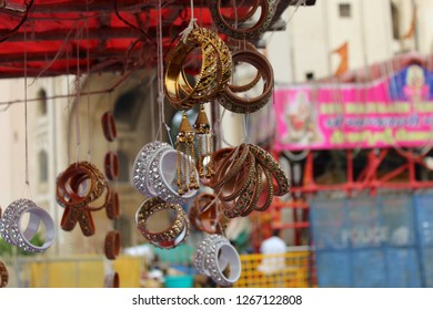 Beautiful bangles, earrings, wedding jewelers selling on the road at the Charminar bazar, Hyderabad, India.