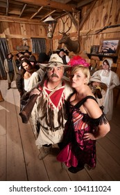 Beautiful bar maid with handsome trapper in saloon