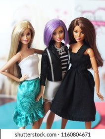 A beautiful barbie with long white, violet and brown hair. Stylish dolls. Editorial use only.