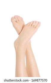 Beautiful bare woman's feet. Isolated on white.