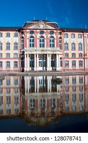 Beautiful baroque castle Bruchsal in Germany with water reflection