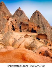 Beautiful barren landscape - ancient cave orthodox monastery Selime (unesco world heritage site) in ashen mountain (volcanic rock), Aksaray Province, Cappadocia, Central Anatolia, Turkey