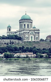 Beautiful basilica and Danube river in Esztergom, Hungary. Cultural heritage. Travel destination. Place of worship. Religious architecture. Blue photo filter.