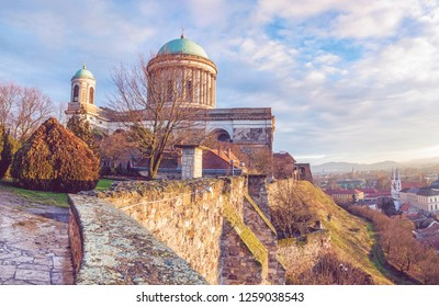 Beautiful basilica in Esztergom et sunset, Hungary. Cultural heritage. Travel destination. Largest building. Place of worship. Religious architecture. Purple photo filter.