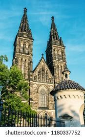 Beautiful basilica of Saint Peter and Saint Paul, Vysehrad, Prague, Czech republic. Sunset photo. Religious architecture. Travel destination. Beauty photo filter.