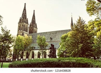 Beautiful basilica of Saint Peter and Saint Paul, Vysehrad, Prague, Czech republic. Religious architecture. Travel destination. Yellow photo filter.