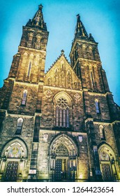 Beautiful basilica of Saint Peter and Saint Paul, Vysehrad, Prague, Czech republic. Evening scene. Religious architecture. Travel destination. Analog photo filter with scratches.