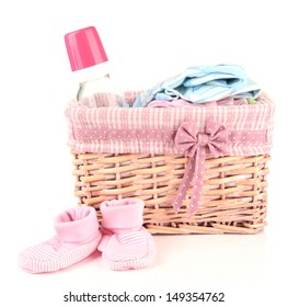 Beautiful basket of baby clothes isolated on white